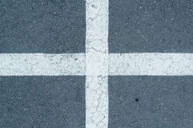 white parking lines on roadway