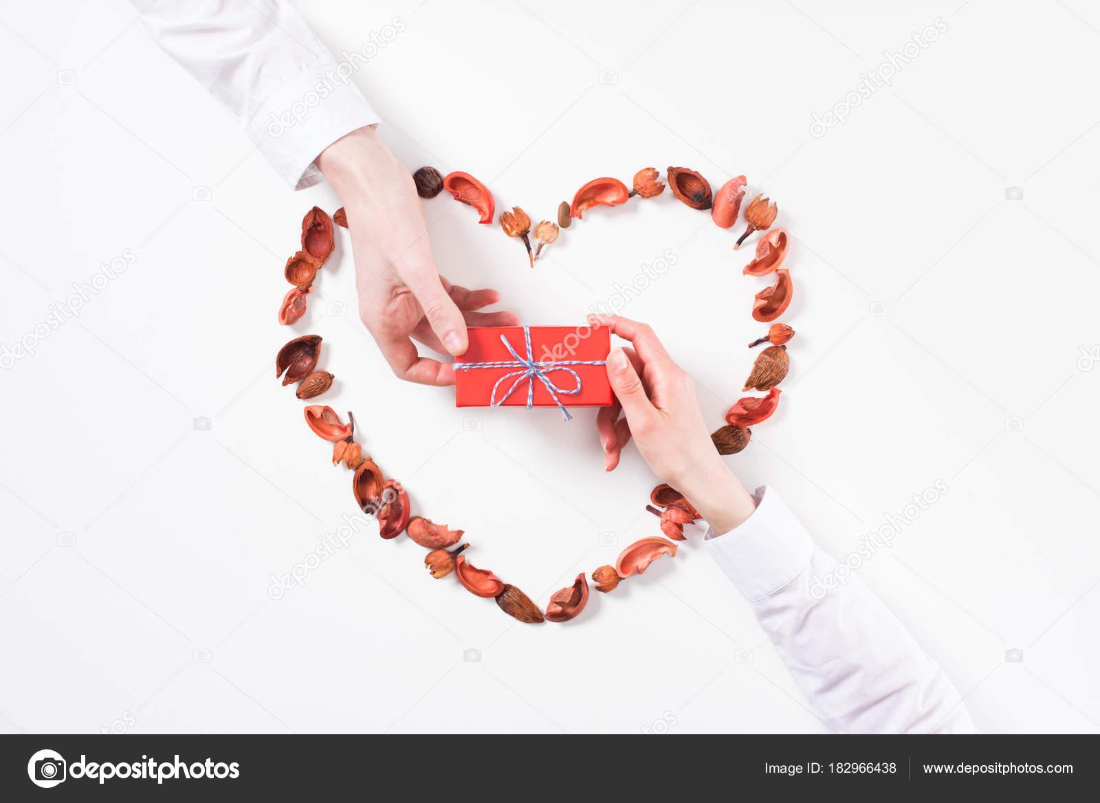 Cropped Image Boyfriend Presenting Girlfriend Gift Valentines Day