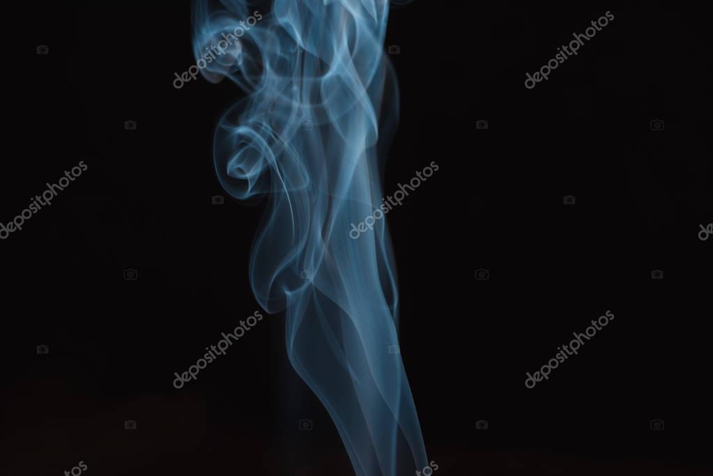 blue and white smoke isolated on black