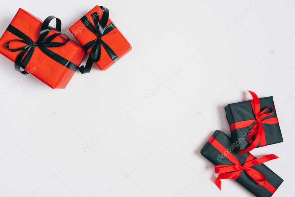 top view of wrapped gifts isolated on grey, st valentines day concept