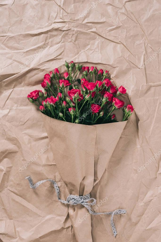 top view of beautiful bouquet of roses on wrapping paper