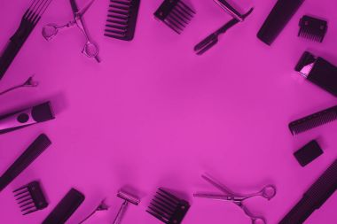 top view of arrangement of various barber tools isolated on purple