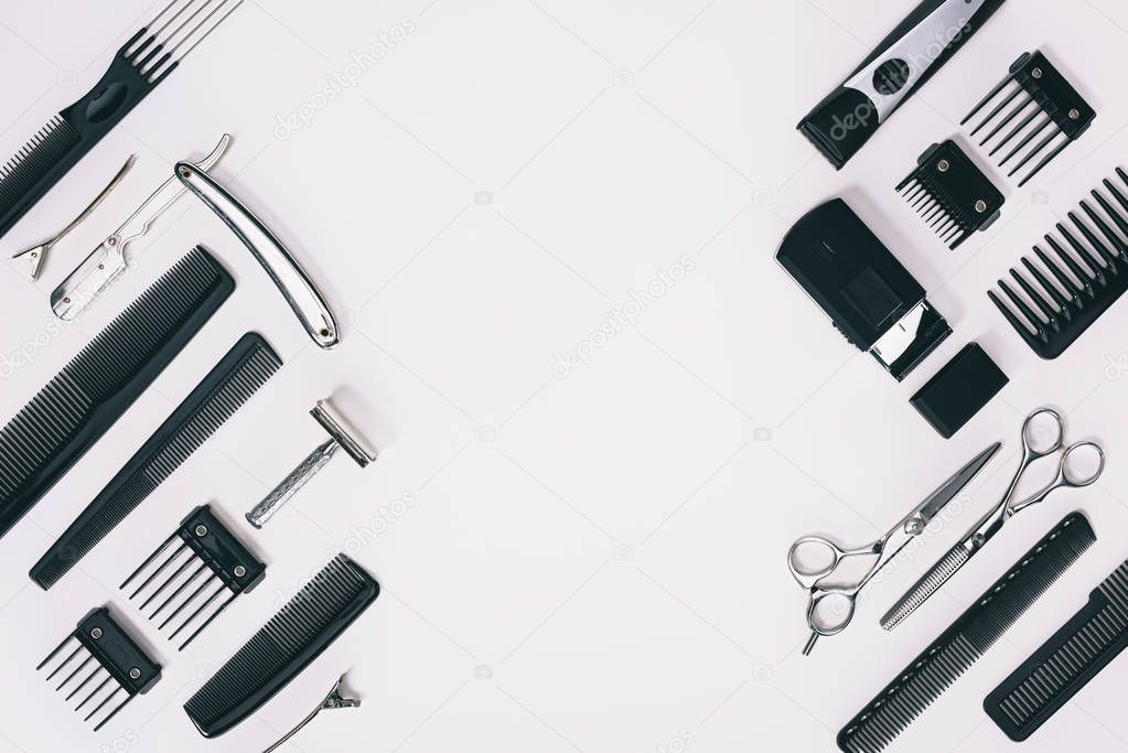 top view of arrangement of various barber tools isolated on grey