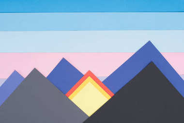 Decorative mountains made of colored paper stock vector