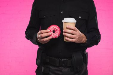 cropped shot of policeman holding doughnut and paper cup of coffee