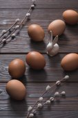 chicken eggs and easter rabbit on wooden table