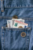 Fotografie close up view of euro banknotes in jeans pocket