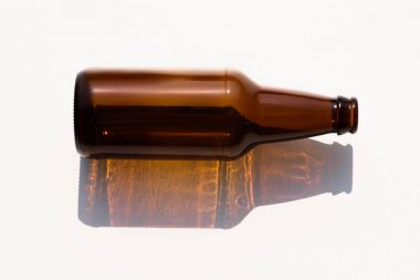 close up view of empty glass bottle on white tabletop