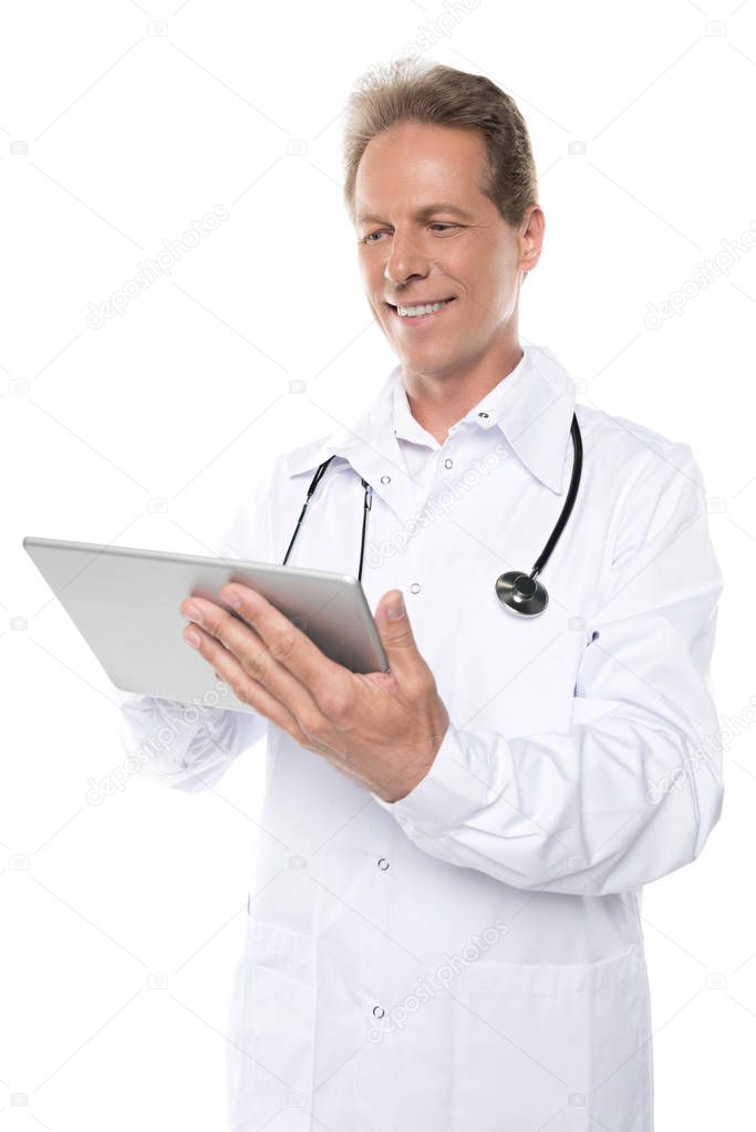 mature doctor in white coat