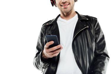 young man in headphones using smartphone