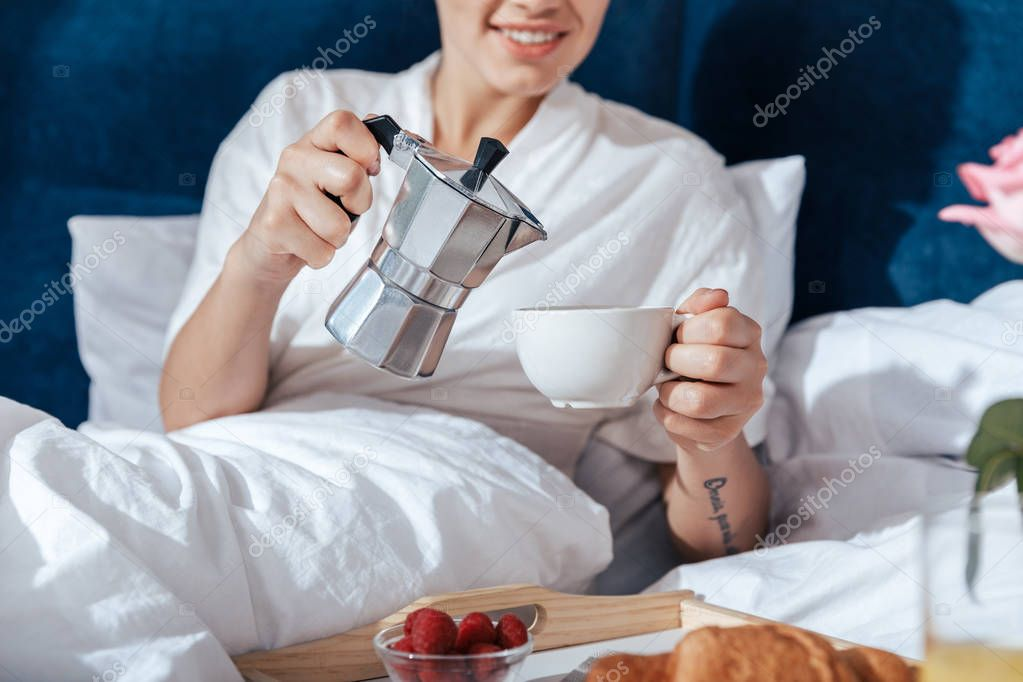 woman having coffee in bed