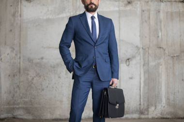 Confident businessman with briefcase