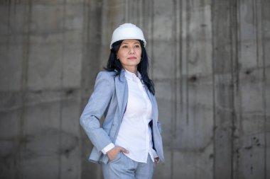 Beautiful businesswoman in hard hat