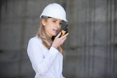 Engineer using walkie-talkie
