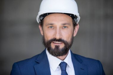 Middle aged businessman in hard hat