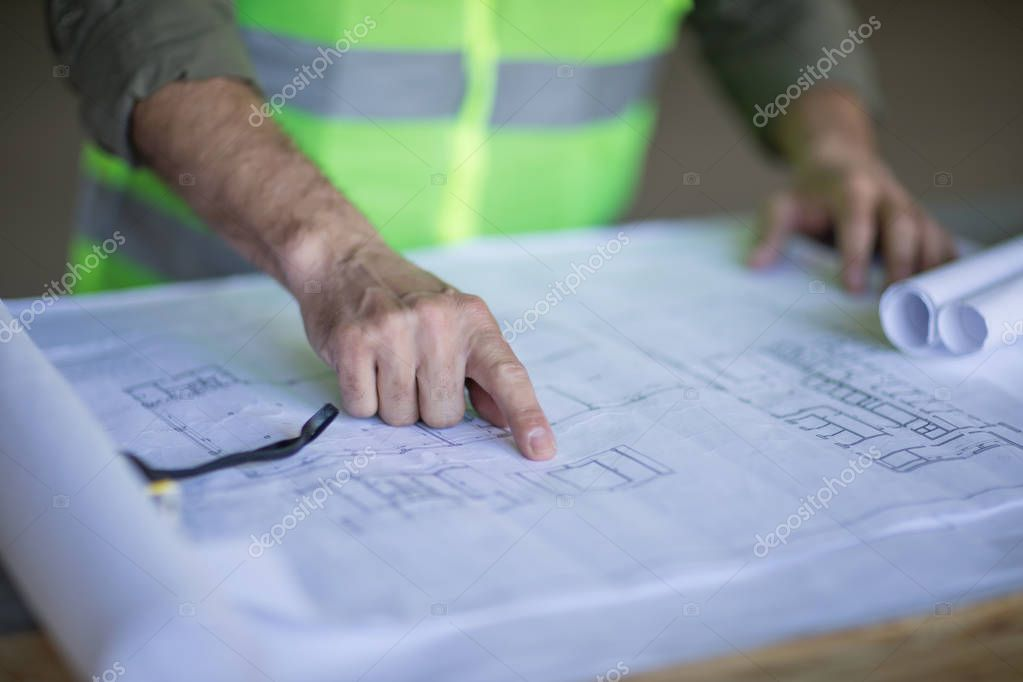 Engineer working with blueprints