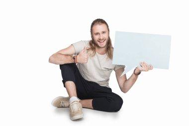 man holding empty speech bubble
