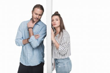 Young couple separated by wall