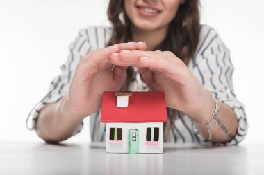 Young woman with house model
