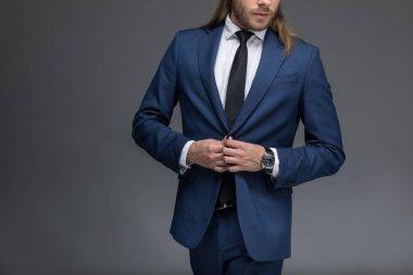 young elegant businessman in suit