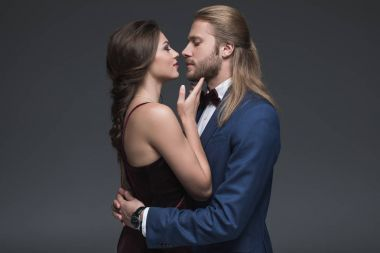 couple in formal wear able to kiss