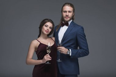 young couple in evening outfit with champagne
