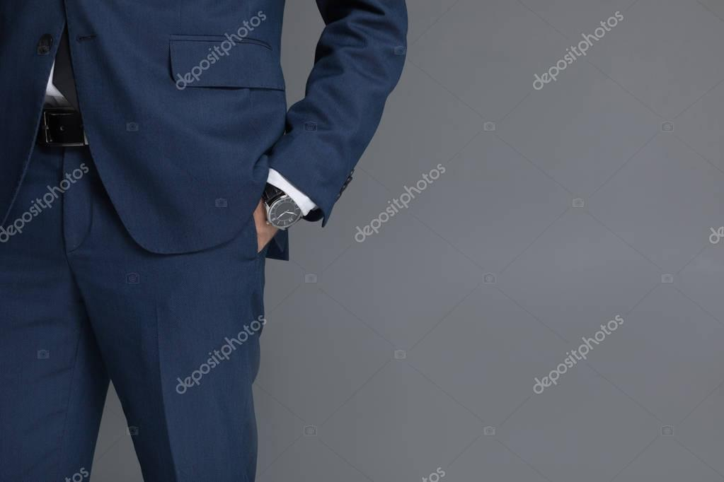 businessman in formal wear with hand watches