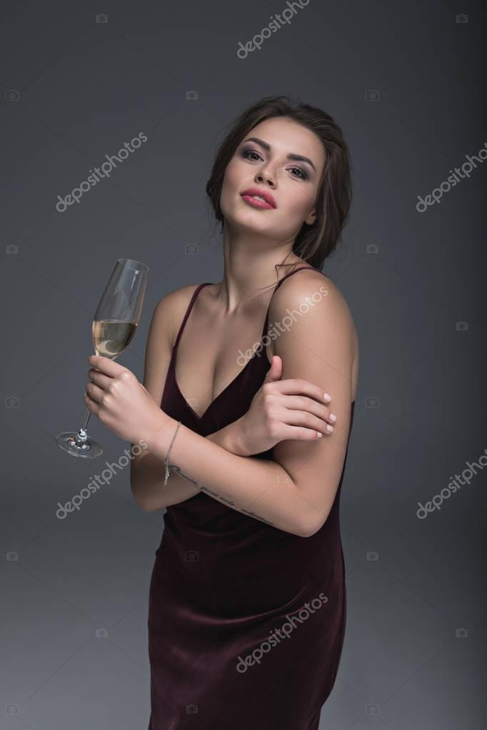 young lady holding glass of champagne