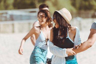 Friends walking at beach