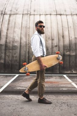 stylish man with longboard