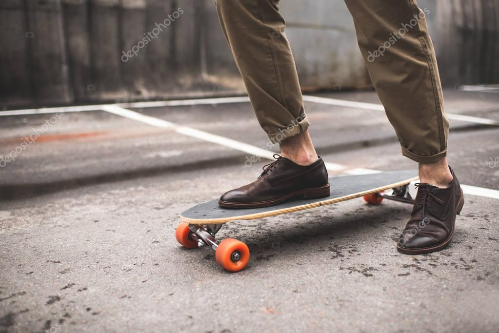 stylish man on longboard