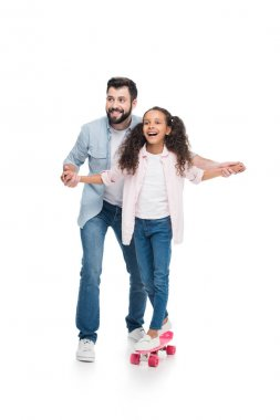 Father and daughter with skateboard