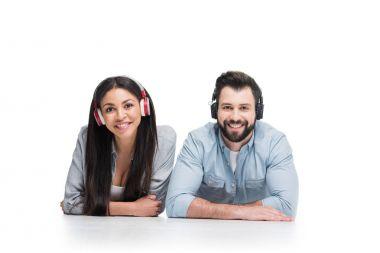 Happy young couple in headphones