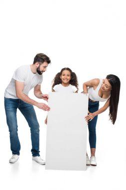 family holding banner