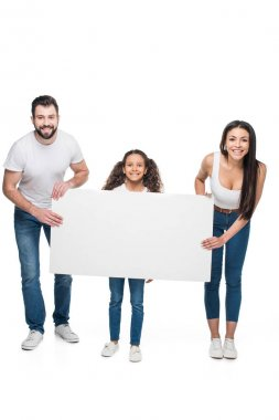 Happy multiethnic family holding blank banner isolated on white stock vector