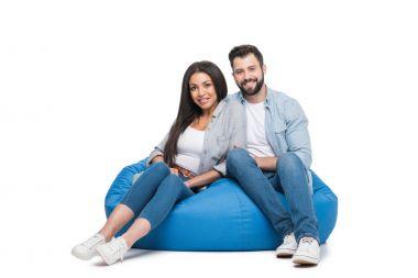 Couple sitting on bag chair