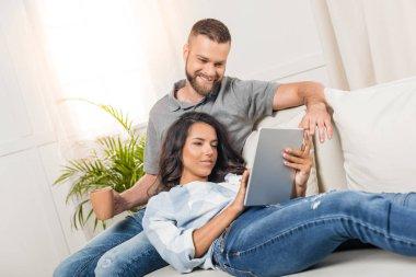 Couple using digital tablet