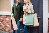 Fotografie couple with shopping bags on street