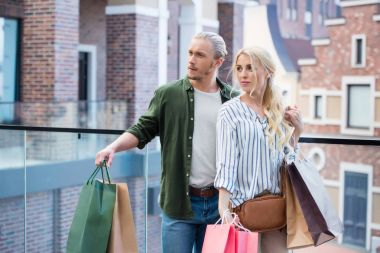 Couple with shopping bags at mall