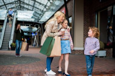 mother with kids shopping at mall