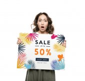 woman holding sale banner