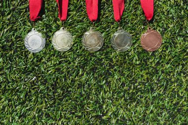 various medals on grass