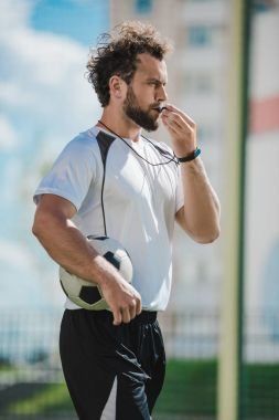 soccer referee with whistle