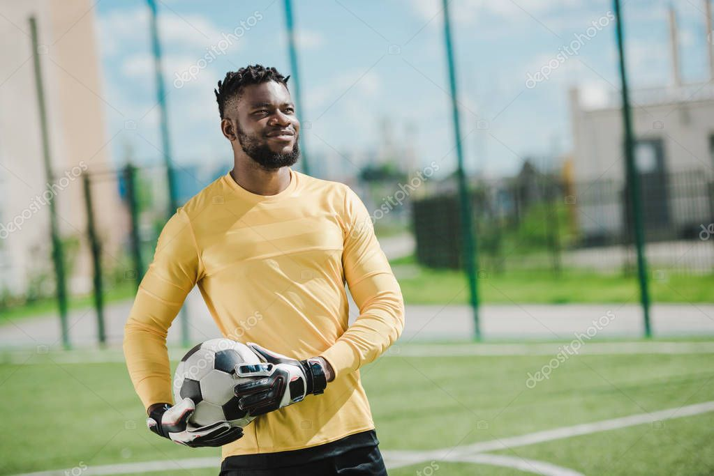 african american goalkeeper with ball