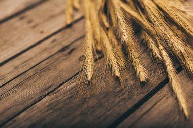 Ripe wheat on table