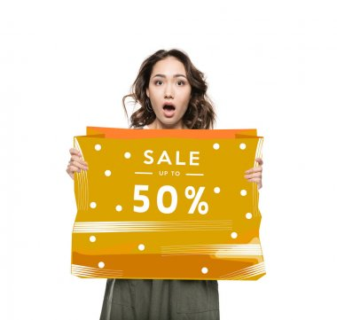 Shocked asian woman holding orange sale banner with fifty percent off isolated on white stock vector