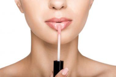 woman applying lipgloss