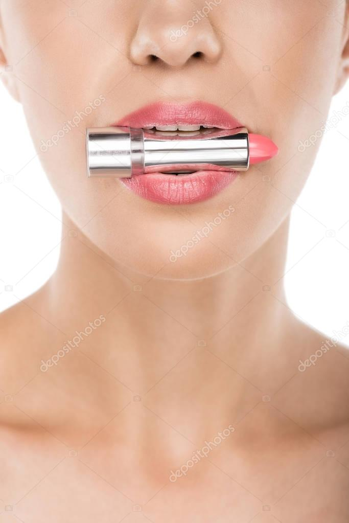 woman holding lipstick in mouth
