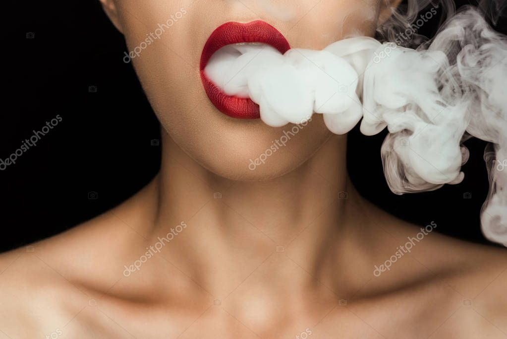 woman blowing smoke