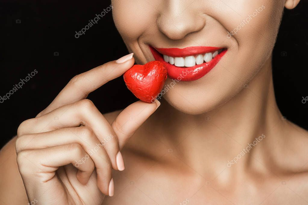 woman with heart shaped candy